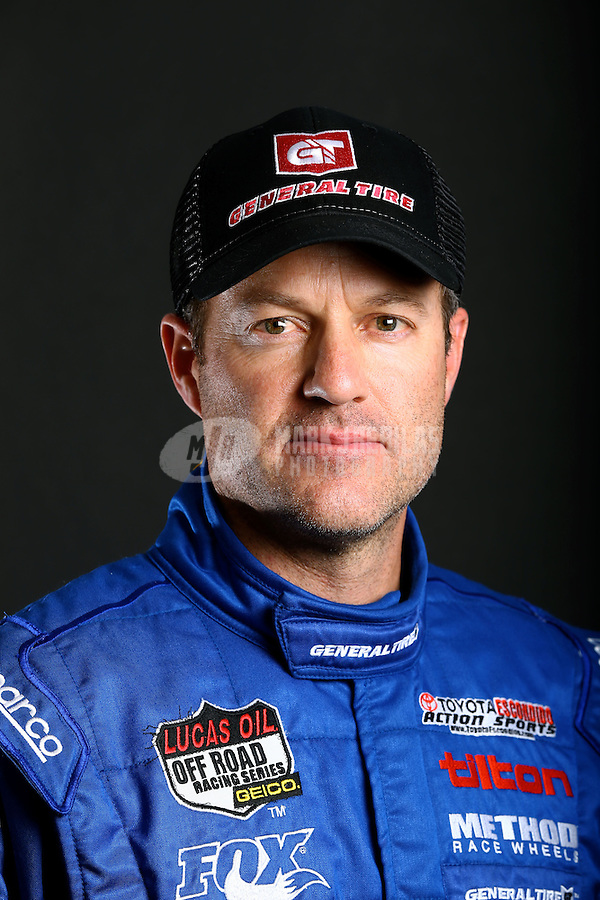 Mar. 21, 2014; Chandler, AZ, USA; LOORRS pro 4 driver Doug Fortin poses for a portrait prior to round one at Wild Horse Motorsports Park. Mandatory Credit: Mark J. Rebilas-USA TODAY Sports