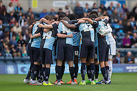 Wycombe Wanderers pre match team huddle during the Sky Bet League 2 match between Wycombe Wanderers and Hartlepool United at Adams Park, High Wycombe, England on 5 September 2015. Photo by Andy Rowland.