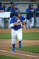 Tim Locastro (15) of the Rancho Cucamonga Quakes runs to first base during a game against the Lake Elsinore Storm at LoanMart Field on April 10, 2016 in Rancho Cucamonga, California. Lake Elsinore defeated Rancho Cucamonga, 7-6. (Larry Goren/Four Seam Images)