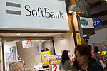 May 10, 2016, Tokyo, Japan - People walk past a SoftBank shop in downtown Tokyo, Japan on May 10, 2016. SoftBank Group Corp. reported a drop in operating profit to 124 billion yen and a net profit of 45 billion yen. (Photo by AFLO)
