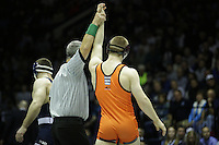 STATE COLLEGE, PA -DECEMBER 19: Zach Epperly of the Virginia Tech Hokies gets his arm raised after winning his match on December 19, 2014 at Recreation Hall on the campus of Penn State University in State College, Pennsylvania. Penn State won 20-15. (Photo by Hunter Martin/Getty Images) *** Local Caption *** Zach Epperly