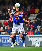 Lincoln City's Jason Shackell vies for possession with  Crewe Alexandra's James Jones, front, and Chris Porter<br /> <br /> Photographer Andrew Vaughan/CameraSport<br /> <br /> The EFL Sky Bet League Two - Lincoln City v Crewe Alexandra - Saturday 6th October 2018 - Sincil Bank - Lincoln<br /> <br /> World Copyright &copy; 2018 CameraSport. All rights reserved. 43 Linden Ave. Countesthorpe. Leicester. England. LE8 5PG - Tel: +44 (0) 116 277 4147 - admin@camerasport.com - www.camerasport.com