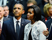 "United States President Barack Obama (L) comforts his wife first lady Michelle Obama at the event ""Together We Thrive: Tucson and America"" honoring the January 8 shooting victims at McKale Memorial Center on the University of Arizona campus on Wednesday, January 12, 2011 in Tucson, Arizona. The memorial service is in honor of victims of the mass shooting at a Safeway grocery store that killed six and injured at least 13 others, including U.S. Representative Gabrielle Giffords (Democrat of Arizona), who remains in critical condition after being shot in the head. Among those killed were U.S. District Judge John Roll, 63; Giffords' director of community outreach, Gabe Zimmerman, 30; and 9-year-old Christina Taylor Green. .Credit: Kevork Djansezian / Pool via CNP"