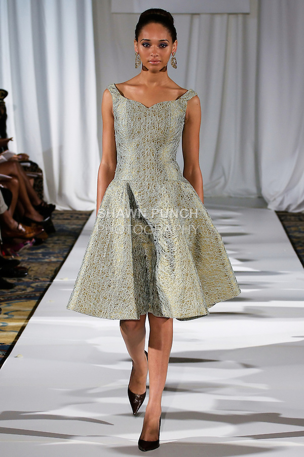 Sharminia walks runway in a garden green celadon lace overlay party dress, from the b Michael AMERICA Couture Spring 2013 collection during Mercedes-Benz Fashion Week Spring 2013, at the Jumeirah Essex House on September 12, 2012.