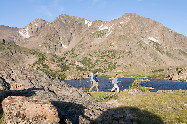couple hiking, (MR), hike, alpine, tundra, Rowe Mountain, Rowe Peak distant, high elevation, recreation, outdoors, activity, August, morning, Rocky Mountain National Park, Colorado, USA