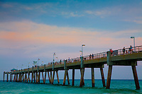 Visitors to Okaloosa Island Pier overlook emerald water and sunset-streaked skies in Fort Walton Beach. ..COLIN HACKLEY PHOTO