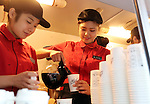 January 12, 2017, Tokyo, Japan - McDonald's Japan employees prepare free sample coffee at a promotional event for McDonald's new coffee in Tokyo on Thursday, January 12, 2017. The hamburger restaurant chain will launch the new taste coffee at their restaurants from January 16.   (Photo by Yoshio Tsunoda/AFLO) LWX -ytd-