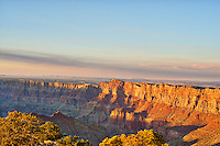 This is another photo we took at the Grand Canyon in Arizona. It was right before the sun set and there was this nice golden glow over the canyons. The landscape of the grand canyon is a very powerful place and at times can take your breath away. The canyon are a gelogic wonder in that are constantly eroding and changing over time. The Colorado river runs through the canyon and is ever changing the canyons as more and more of the rock below are exposed.