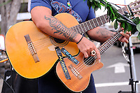 Busker in Kailua-Kona, playing guitar and ukulele. Big Island, Hawaii