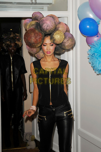 Model<br /> The Tatiana Hair Extensions LFW Avant Garde Catwalk Collection, Tatiana Hair Extensions, Kensington, London, England. <br /> 11th September 2013<br /> fashion week half length black top leather trousers balls baubles <br /> CAP/MAR<br /> &copy; Martin Harris/Capital Pictures