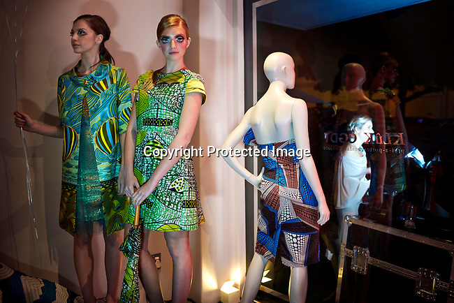 CAPE TOWN, SOUTH AFRICA - JULY 26: Model stand during an installation show at the new Klûk CGDT flagship store during Mercedes-Benz Fashion Week on July 26, 2014, in Cape Town, South Africa. Klûk CGDT, created by the designers Malcolm KLûK and Christiaan Gabriel Du Toit. The elite of Cape Town came out for the launch of the store and the late night party. (Photo by Per-Anders Pettersson)