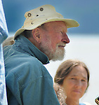 "Festival Founder, Pete Seeger, sits in a golf cart, watching the Arm-of-the-Sea Theater performance of the play, ""CITY that DRINKS the MOUNTAIN SKY,"" performed at the edge of the Hudson River during the 2012 Clearwater Festival at Croton Point Park on Saturday, June 16, 2012. Photograph taken by Jim Peppler. Copyright Jim Peppler/2012"