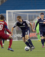 New England Revolution forward Ilija Stolica (9) dribbles. In a Major League Soccer (MLS) match, Real Salt Lake defeated the New England Revolution, 2-0, at Gillette Stadium on April 9, 2011.