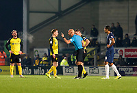 3rd December 2019; Pirelli Stadium, Burton Upon Trent, Staffordshire, England; English League One Football, Burton Albion versus Southend United; Referee Darren Drysdale gives Stephen Quinn of Burton Albion a warning after a tackle - Strictly Editorial Use Only. No use with unauthorized audio, video, data, fixture lists, club/league logos or 'live' services. Online in-match use limited to 120 images, no video emulation. No use in betting, games or single club/league/player publications