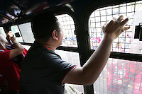 United States fans who had taken public transit to the game cheer and chant at Mexican fans after they are placed on a Mexican police transport bus leaving Azteca Stadium under a police escort. Mexican police officers in riot gear separated the team's fan supporters to prevent any violence and fearing for the fan's safety, Mexican police transported the United States fans to a different subway stop to travel back to their hotels. The United States Men's National Team played Mexico in a CONCACAF World Cup Qualifier match at Azteca Stadium in, Mexico City, Mexico on Wednesday, August 12, 2009.