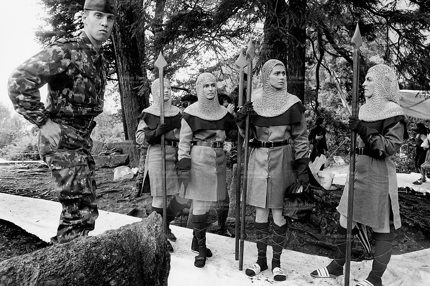 Switzerland. Canton Uri. Rütli. 1 August 1991. Swiss national holiday. Public holiday.  A soldier wearing a military outfitt stands close to a group of dancers, all women dressed as soldiers from the Middles Ages and holding spears in their hands. Rütli (or Grütli in French) is a mountain meadow in the Seelisberg municipality of the Swiss canton of Uri. Here the oath of the Rütlischwur is said to have occurred, the legendary turning-point in the pursuit of independence. Every August 1, on the Swiss National Day, the oath is re-enacted to commemorate the forming of the Old Swiss Confederacy. Rütli is the birthplace of the Swiss Confederation. 1.08.1991 © 1990 Didier Ruef