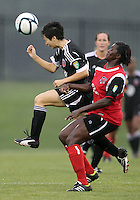 BOYDS, MARYLAND - July 21, 2012:  Diane Weigel (15) of DC United Women heads the ball away from Stephanie Goddard (21) of the Virginia Beach Piranhas during a W League Eastern Conference Championship semi final match at Maryland Soccerplex, in Boyds, Maryland on July 21. DC United Women won 3-0.