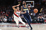 Portland Trail Blazers guard CJ McCollum (3) chases down Denver Nuggets guard Will Barton (5) in the first half at Moda Center.<br /> Photo by Jaime Valdez