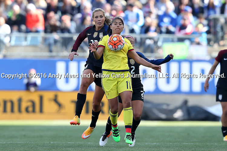 10 April 2016: Catalina Usme (COL) (11) is chased by Allie Long (USA) (23) and Mallory Pugh (USA) (2). The United States Women's National Team played the Colombia Women's National Team at Talen Energy Stadium in Chester, Pennsylvania in an women's international friendly soccer game. The U.S. won the match 3-0.