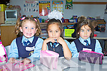 Rhianne O'Brien, Callista Penggai and Olivia Pawlak having fun on their first day of school in St Olivers NS Killarney on Monday..