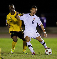 Mobi Fehr (6) of the United States passes the ball away from Jason Wright (10) of Jamaica during the semifinals of the CONCACAF Men's Under 17 Championship at Catherine Hall Stadium in Montego Bay, Jamaica. The United States defeated Jamaica, 2-0.