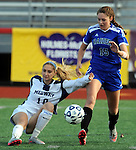(Brockton MA 11/14/15) Medway 10, Sarah DiPillo falls while chasing the ball with Dover-Sherborn 15, Annika Linden, during  the division three south girls soccer final, Saturday, November 14, 2015, at Brockton High School. Herald Photo by Jim Michaud