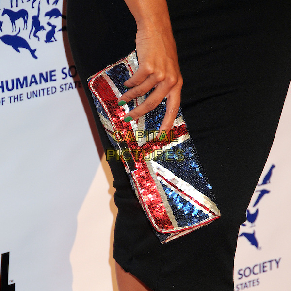 LEONA LEWIS' BAG .25th Anniversary Genesis Awards held at the Hyatt Regency Century Plaza, Century City, California, USA, .19th March 2011..detail union jacket flag sequined sequin clutch purse hand green nails nail varnish polish .CAP/ADM/BP.©Byron Purvis/AdMedia/Capital Pictures.