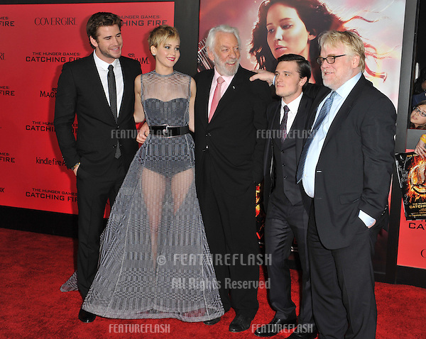 Jennifer Lawrence with Liam Hemsworth (left), Donald Sutherland, Josh Hutcherson &amp; Philip Seymour Hoffman at the US premiere of their movie &quot;The Hunger Games: Catching Fire&quot; at the Nokia Theatre LA Live.<br /> November 18, 2013  Los Angeles, CA<br /> Picture: Paul Smith / Featureflash