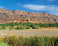Hilltop casbah (fortified village) in the valley of the River Draa, southern Morocc