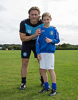 Wycombe Manager Gareth Ainsworth poses with Taylor for a photo as Ballboy Taylor Hunt  at Wycombe Wanderers Training Ground, High Wycombe, England on 25 August 2015. Photo by Andy Rowland.