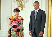 United States President Barack Obama presents the 2015 National Medal of Arts to Sandra Cisneros, Author of San Antonio, Texas during a ceremony in the East Room of the White House in Washington, DC on Thursday, September 22, 2016.<br /> Credit: Ron Sachs / CNP