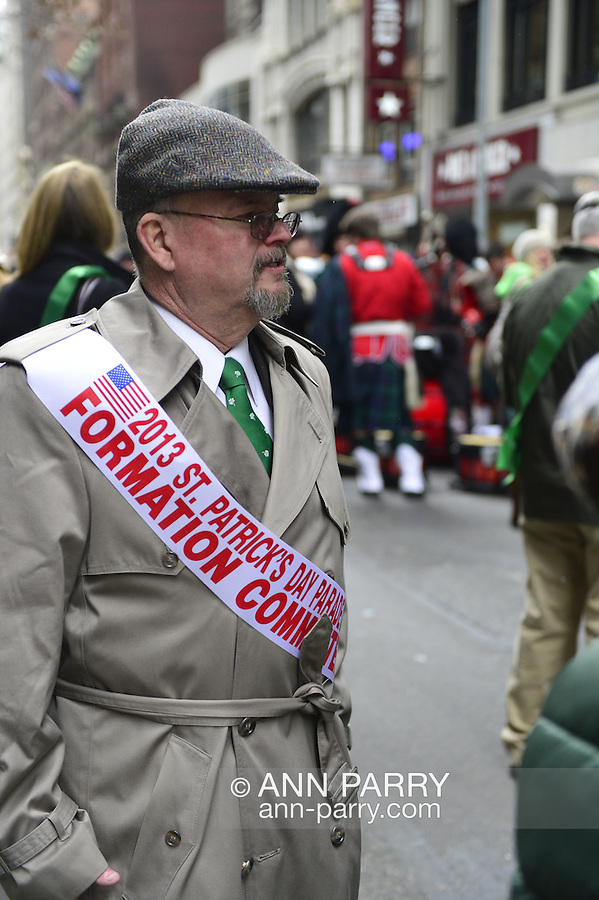 March 16, 2013 - New York, NY, U.S. - Man wearing sash that identifies him as member of 2013 St. Patrick's Day Parade Formation Committee, on Fifth Avenue, at the 252nd annual NYC St. Patrick's Day Parade.