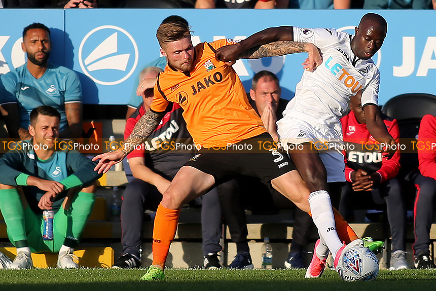Barnet's Elliott Johnson and Modou Barrow of Swansea challenge for the ball as Swansea Manager, Paul Clement looks on during Barnet vs Swansea City, Friendly Match Football at the Hive Stadium on 12th July 2017