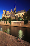 The night view of Notre-Dame Notre Dame cathedral with River Seine in foreground from Left Bank. city of Paris. Paris. France