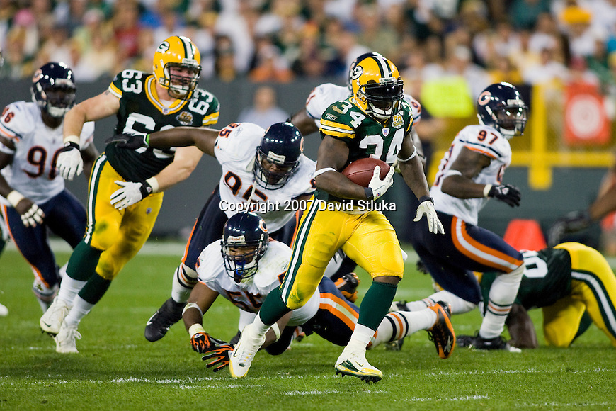 Running back Vernand Morency #34 of the Green Bay Packers carries the ball during an NFL football game against the Chicago Bears at Lambeau Field on October 7, 2007 in Green Bay, Wisconsin. The Bears beat the Packers 27-20. (Photo by David Stluka)