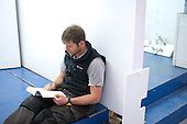 Plumbing student reads a book in a break, Able Skills, Dartford, Kent.