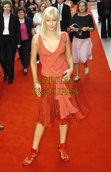 "ALICE EVANS.""King Arthur"" UK Premiere, Leicester Square, London,.15th July 2004..full length sheer red dress see through see thru satin shoes boots.Ref: PL.www.capitalpictures.com.sales@capitalpictures.com.©Capital Pictures."