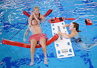 NWA Democrat-Gazette/BEN GOFF @NWABENGOFF<br /> Cody Kehmeier (left rear) and Kathryn Charlson practice loading 'patient' Conner Beringer, all of Bentonville, onto a backboard on Sunday Nov. 15, 2015 while taking a lifeguard class at the Bentonville Community Center.