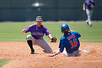 Colorado Rockies second baseman Jeff Moberg (67) reaches to apply the tag to Christopher Morel (16) on a stolen base attempt during an Extended Spring Training game against the Chicago Cubs at Sloan Park on April 17, 2018 in Mesa, Arizona. (Zachary Lucy/Four Seam Images)