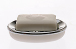 bar of white soap on soap dish on shadowless white background