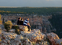 Aug. 22, 2014; GRAND CANYON, AZ, USA; Visitors on the south rim of the Grand Canyon at sunset in northern Arizona. The canyon has been formed over millions of years by the Colorado River cutting its way through the desert. Mandatory Credit: Mark J. Rebilas