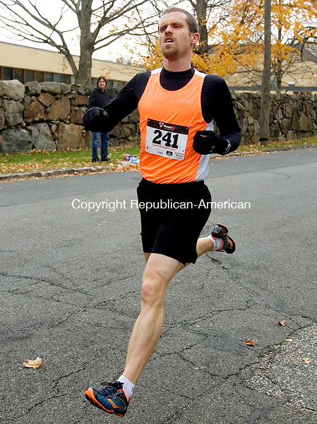 MIDDLEBURY CT. 09 November 2013-110913SV06-Kyle Morse of Waterbury finishes first during the sixth annual Pilgrim's Pace 5K, sponsored by the Middlebury Congregational Church, in Middlebury Saturday. <br /> Steven Valenti Republican-American
