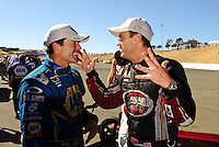 Jul. 18, 2010; Sonoma, CA, USA; NHRA funny car winner Ron Capps (left) talks with top fuel dragster winner Larry Dixon after the Fram Autolite Nationals at Infineon Raceway. Mandatory Credit: Mark J. Rebilas-