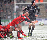 Leicester, England. Jean-Marc Doussain of Toulouse clears the ball during the Heineken Cup match between Leicester Tigers and Toulouse at Welford Road on January  20. 2013 in Leicester, England..