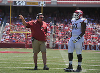 NWA Democrat-Gazette/Michael Woods --04/25/2015--w@NWAMICHAELW... University of Arkansas rcoach Bret Bielema take with Brian Wallace during the 2015 Red-White game Saturday afternoon at Razorback Stadium in Fayetteville.