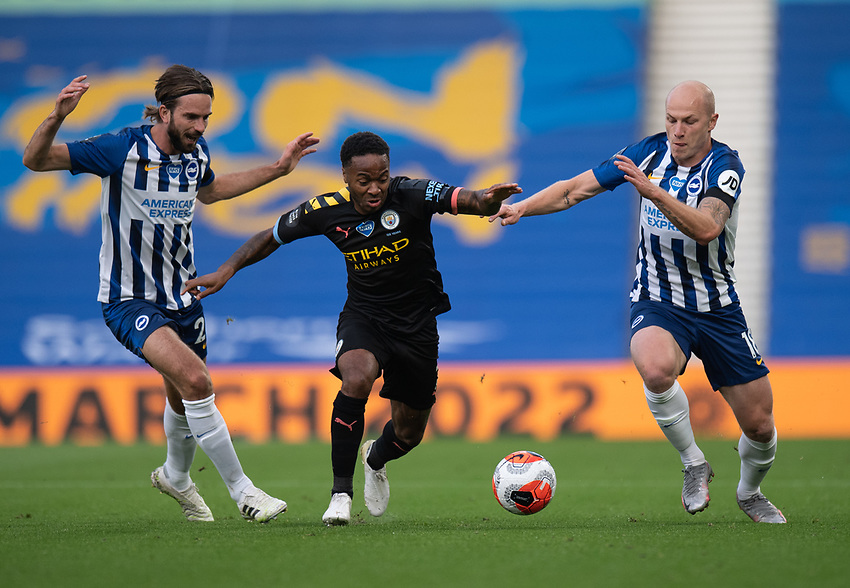 Manchester City's Raheem Sterling (centre) under pressure from Brighton & Hove Albion's Davy Propper (left) and Aaron Mooy (right) <br /> <br /> Photographer David Horton/CameraSport<br /> <br /> The Premier League - Brighton & Hove Albion v Manchester City - Saturday 11th July 2020 - The Amex Stadium - Brighton, Raheem Sterling, Davy Propper, Aaron Mooy<br /> <br /> World Copyright © 2020 CameraSport. All rights reserved. 43 Linden Ave. Countesthorpe. Leicester. England. LE8 5PG - Tel: +44 (0) 116 277 4147 - admin@camerasport.com - www.camerasport.com