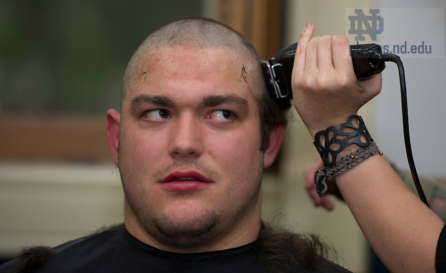 April 18, 2012; Students get their heads shaved during the Bald and the Beautiful annual fundraiser to fight pediatric cancer in the Sorin-Dooley Room in the LaFortune Student Center. Photo by Barbara Johnston/University of Notre Dame