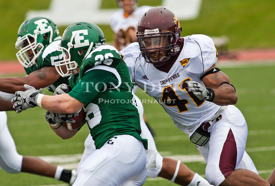 Eastern Michigan running back Corey Welch (26) is wrapped up by Central Michigan linebacker Armond Staten (41) in the first quarter of an NCAA college football game, Saturday, Sept. 18, 2010, in Ypsilanti, Mich. (AP Photo/Tony Ding)
