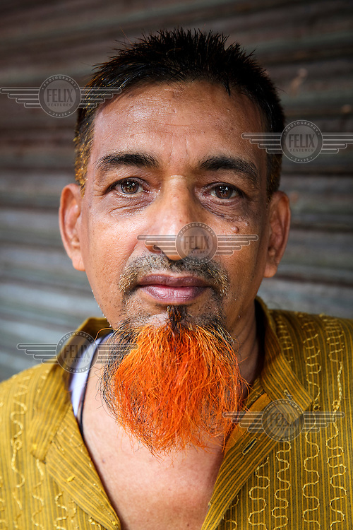 Rafiq.<br /> <br /> It is very common in Bangladesh to see older people with dyed orange hair, men with orange beards or orange moustaches and women with orange hair. The dye used is from the flowering Henna plant. The practice comes from the widely held belief that the Prophet Muhammad dyed his beard and hair. It is also common among people returning from Hajj. Some Muslims believe that henna is the only dye they are free to use for colouring their hair.