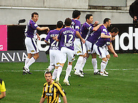 Perth players congratulate Victor Sikora for opening the scoring during the A-League football match between Wellington Phoenix and Perth Glory at Westpac Stadium, Wellington, New Zealand on Sunday, 16 August 2009. Photo: Dave Lintott / lintottphoto.co.nz